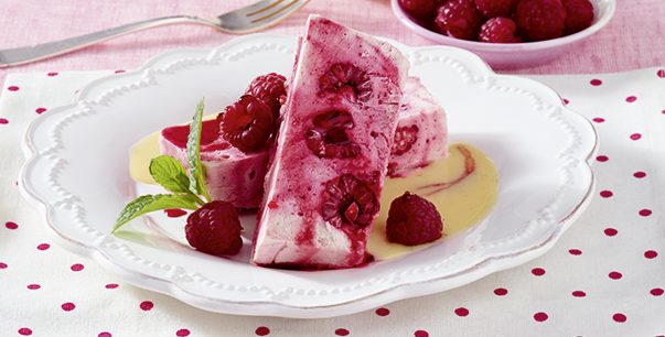 Raspberry parfait with vanilla sauce